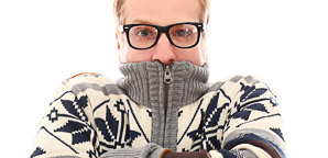 picture of man bundled up, with turtleneck sweater drawn up over his mouth
